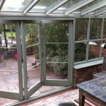 Double glazed hardwood bi-fold doors painted