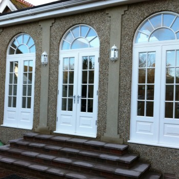 Hardwood french door arch painted white oak