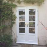 Hardwood French Doors painted white roof lantern