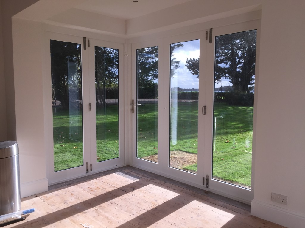 Double glazed wooden bi-fold doors french painted