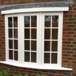 Hardwood double glazed bow window painted white