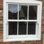Timber sliding sash window painted white hardwood