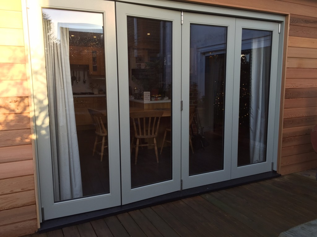 Bi-fold doors fully glazed manufactured accoya painted