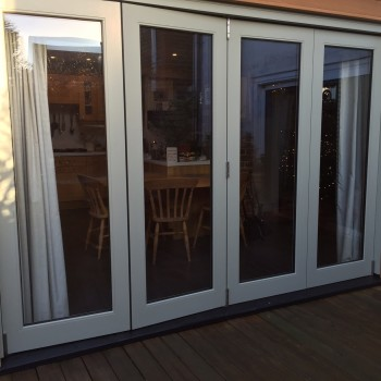 Bi-fold doors fully glazed manufactured accoya painted