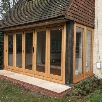 Oak Bifold sliding doors windows bi-fold