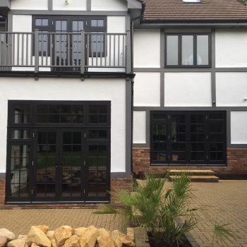 Timber wooden French doors patio black Surrey