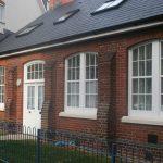 Glazed Wooden casement windows round top door